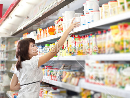 Woman in the supermarket choose food