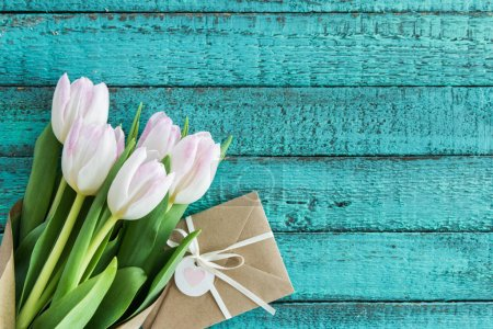 light pink tulips and envelope