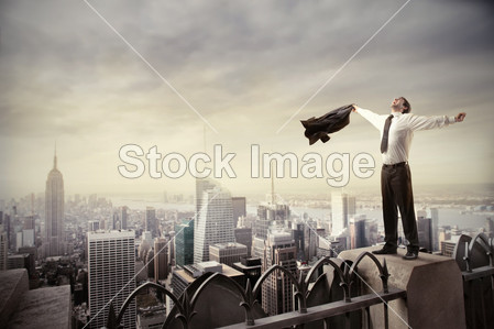 businessman standing on the rooftop