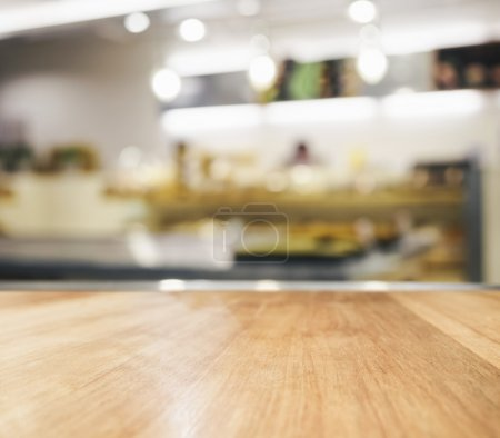 Table top counter with blurred kitchen interior background